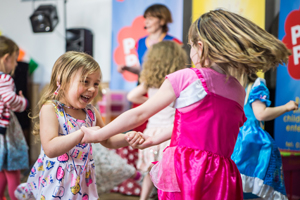 Two girls having fun at a PomPom children's birthday party